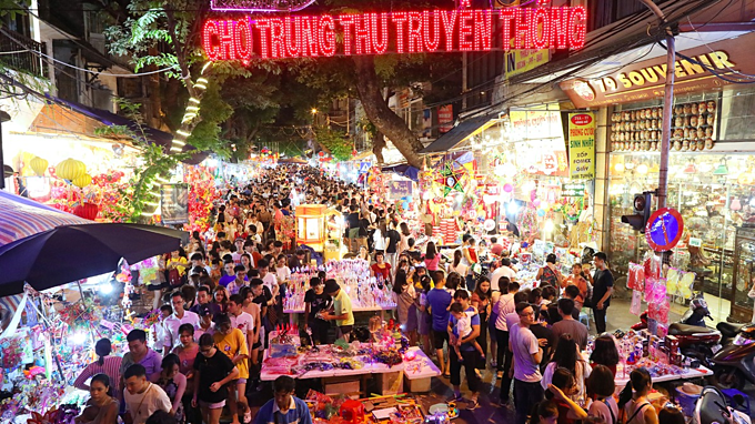 These days, Hang Ma Street, one of the busiest areas in the capital specializing in trading children's toys, paper goods and paper votive offerings, turned into a traditional market during the Mid-Autumn season.The street, which has exister for hundreds of years and a hidden gem of Hanoi normally sells paper votive offerings and home decorations but one month before the festival, it has transformed into a busy shopping area with almost houses and sidewalks turned into makeshift shops, providing star-shaped lanterns, revolving lanterns, and paper masks of animals and fairy tales characters for the childrens favorite festival.For many Vietnamese, the Mid-Autumn Festival,which falls on September 13 this year,is the second most important festival after the Lunar New Year. The Mid-Autumn festival dates back to the Rice Civilization of the Red River delta, over 4,000 years ago.