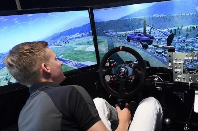 Senior Flight Dynamics Engineer Hans Joore demonstrates a simulator of the PAL-V flying car, developed by Dutch firm PAL-V, at the companys headquarter in Raamsdonksveer on May 30, 2017. Photo by AFP/