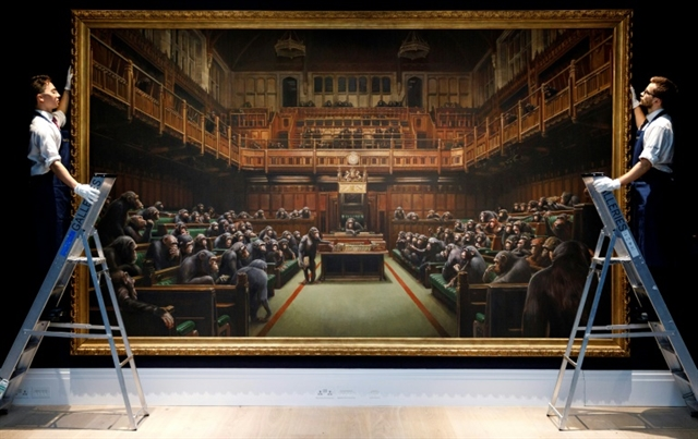 £9.9mn chimp parliament painting smashes Banksy record